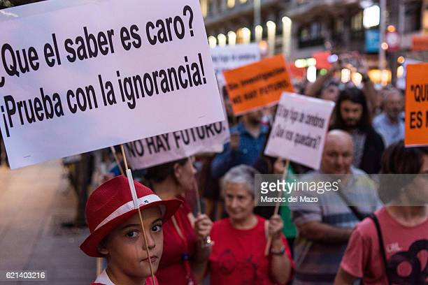 A young boy in a protest in Madrid against cuts in science during the European Night of Researchers