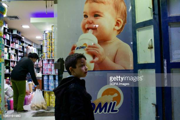 A young boy in a shop seen looking out on the streets of the Dheisheh refugee camp in Palestine