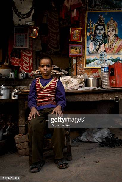 Young boy in a street commerce of Varanasi Uttar Pradesh India