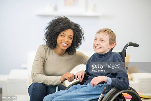 young boy in a wheelchair - developmental disability stock photos and pictures