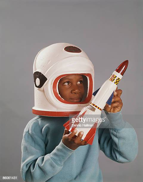 Young Boy in Astronaut Costume with Spaceship
