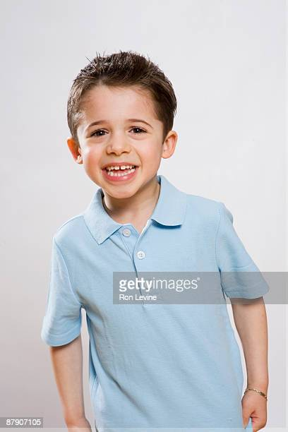 Young boy in blue shirt, laughing