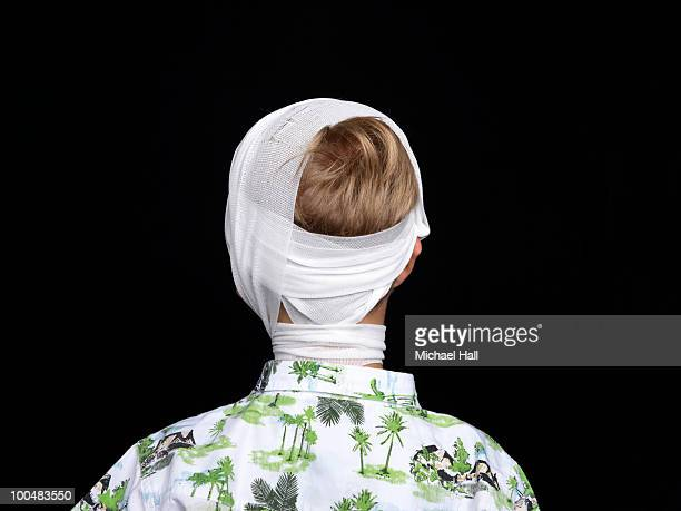 Young boy in head bandage