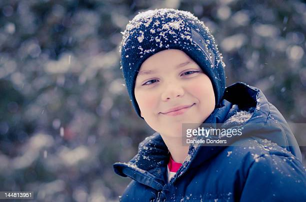 """young boy in snow - """"danielle donders"""" stock pictures, royalty-free photos & images"""