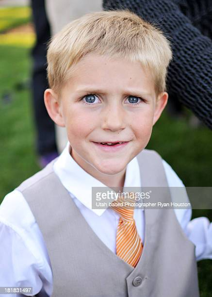 young boy in suit quizzical look on face - utah wedding stock pictures, royalty-free photos & images