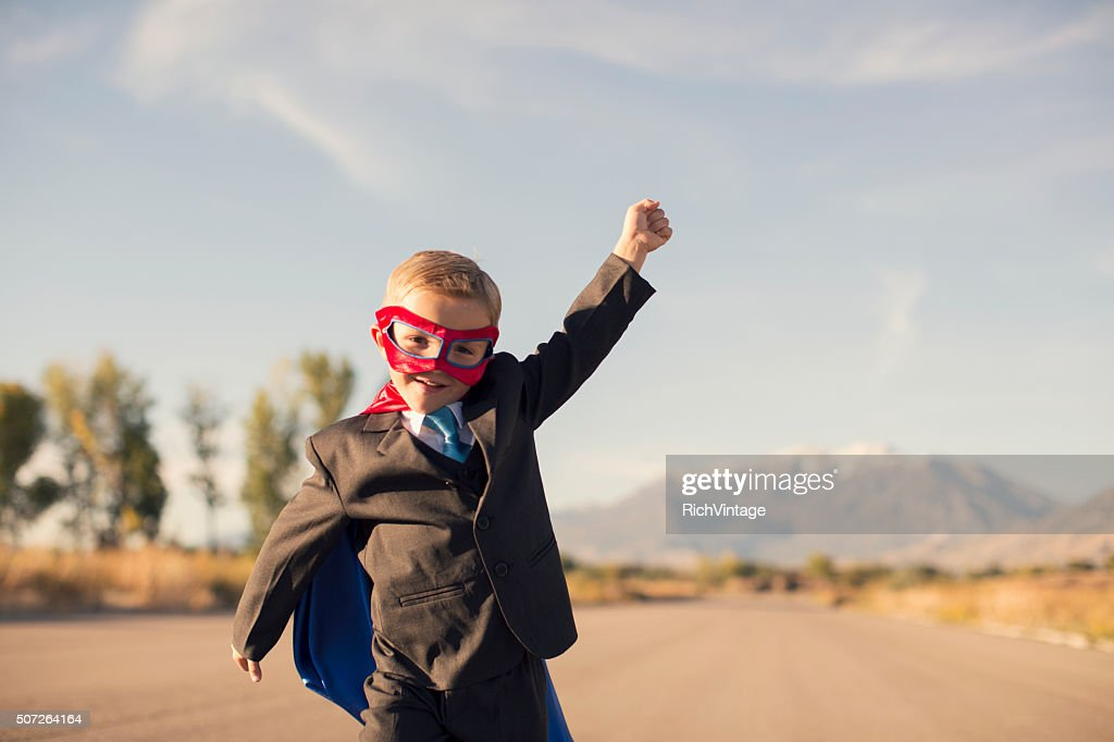 Young Boy in Superhero Costume and Business Suit is Running : Stock Photo