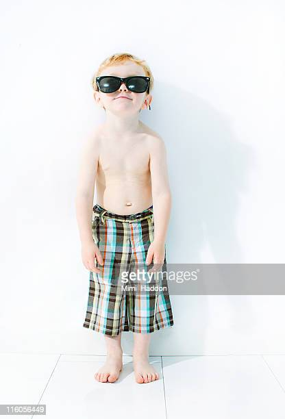 Young Boy in Swim Trunks with Sunglasses
