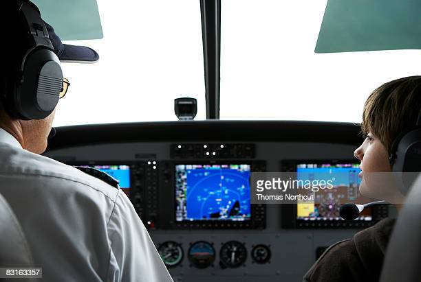 Young boy in the cockpit of a small seaplane.