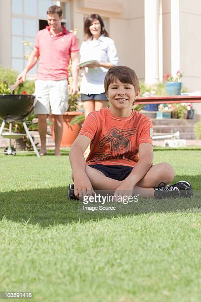 Young boy in the garden with parents
