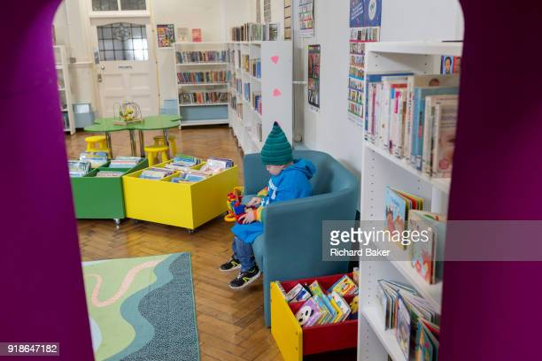 A young boy in the reopened Carnegie Library on Herne Hill in south London which has opened its doors for the first time in almost 2 years on 15th...