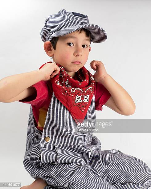 young boy in train engineer costume - kids costume engineer stock photos and pictures