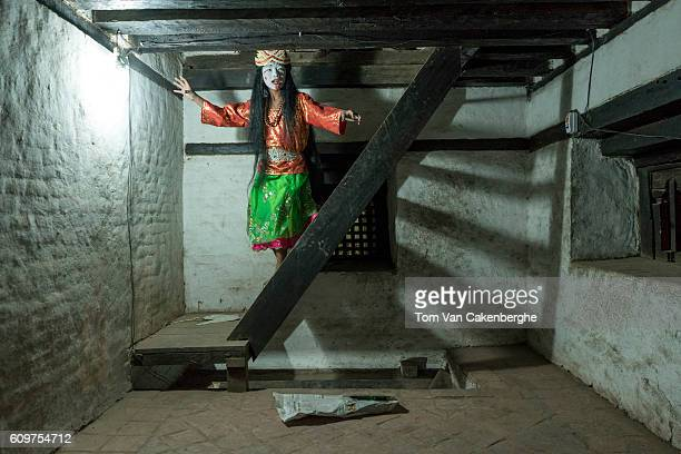 A young boy is dressed up and painted to perform night theater depicting the Dash Avatara or 10 incarnations of Hindu Lord Vishnu during the Indra...