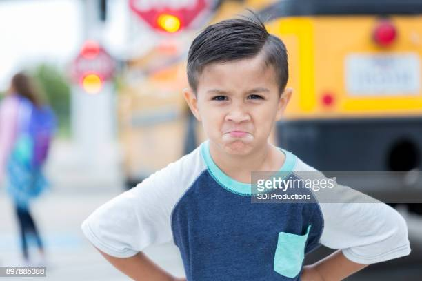 young boy is not ready for the first day of school - stubborn stock pictures, royalty-free photos & images