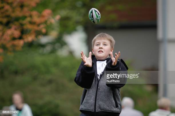 A young boy is seen trying to catch a miniature American football on the Mill Island on 6 May 2017