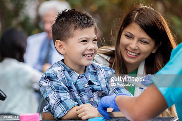 Young boy is treated at outdoor free clinic