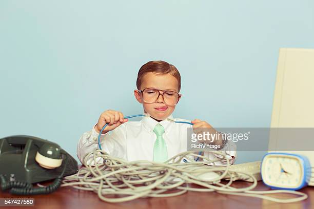 young boy it professional smiles at computer with wire - ケーブル線 ストックフォトと画像