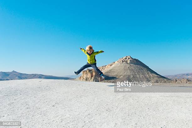 Young boy jumping in mid-air in Cappadocia
