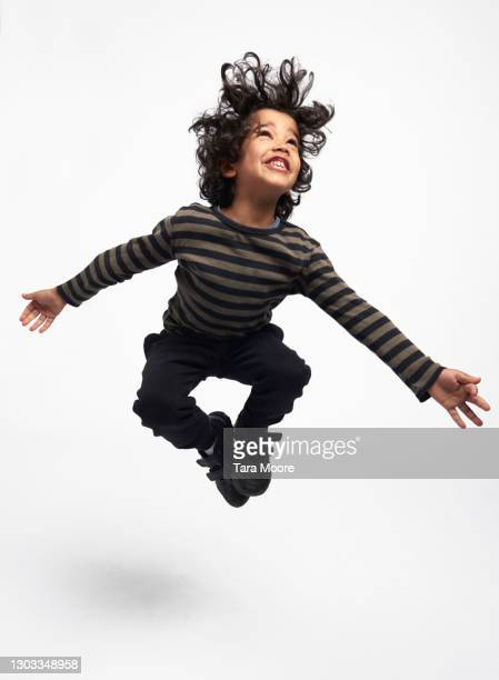young boy jumping - childhood stock pictures, royalty-free photos & images