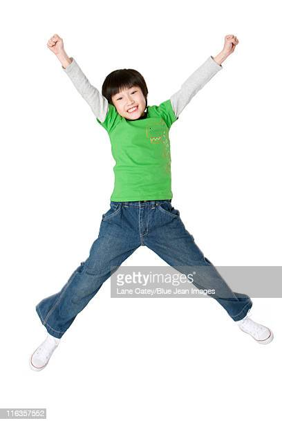 Young boy jumping up with excitement