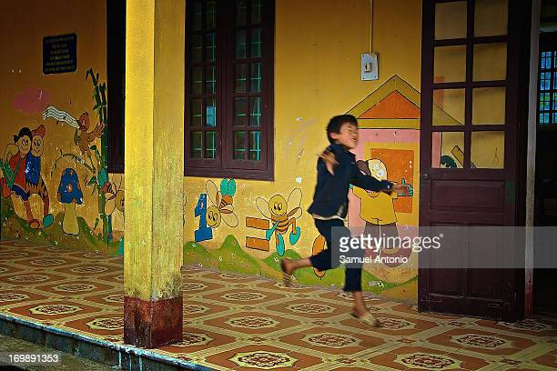 Young boy jumps for joy in front of his school room at the Ta Phin Red Dzao ethnic minority village in Sapa located in the Northeastern part of...