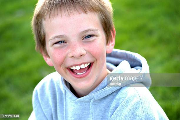 Young Boy Laughing with a Huge Smile Outside
