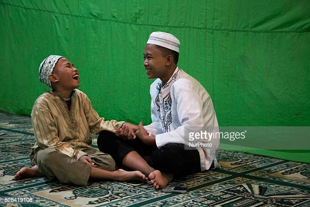 A young boy laughing with his friend before taraweh pray As Ramadhan approached to end moeslim held their last taraweh pray