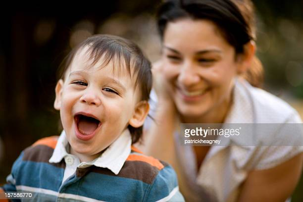 Young boy laughing with mother