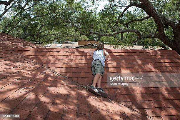 Young Boy Laying on a Roof