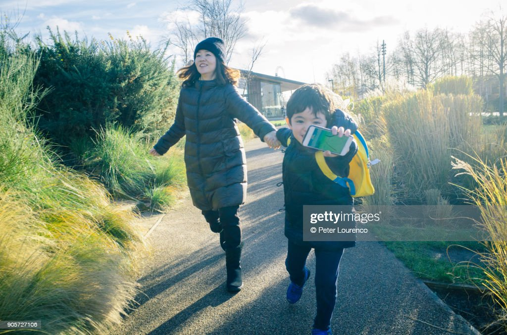 Young boy leading the way : Stock Photo