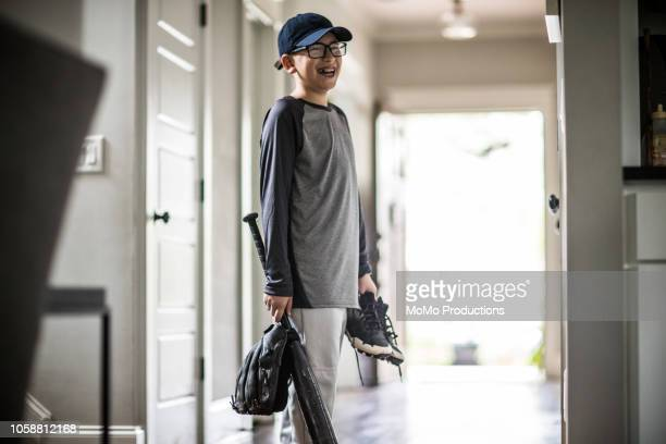 Young boy leaving for baseball practice