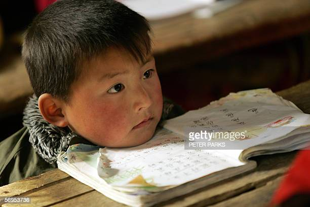 A young boy listens to his teacher at Zhongjunlou Elementary School in rural Anhui province 23 February 2006 Beijing said it planned to increase...