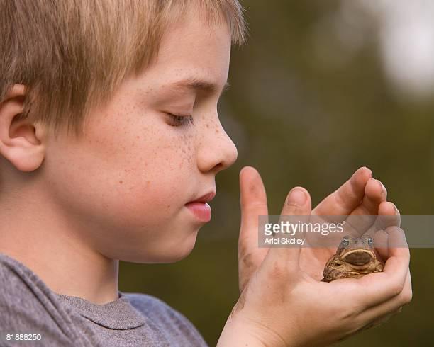 Young Boy Looking at Frog