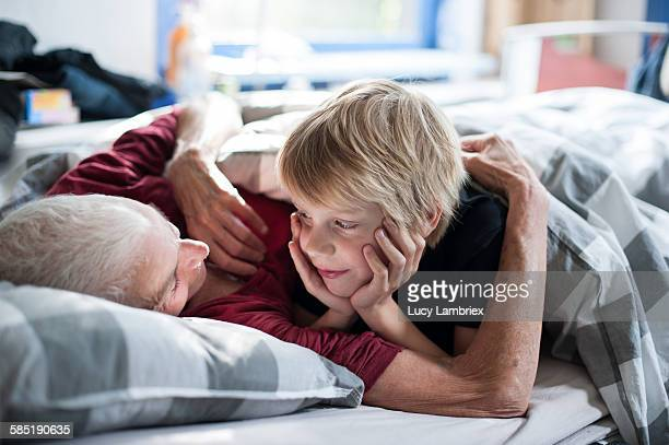 Young boy looking at his grandmother