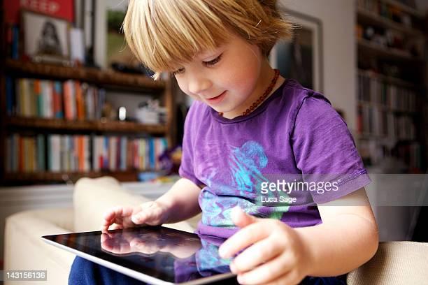 Young boy looking at iPad