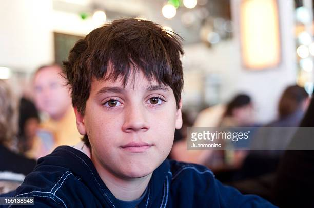 young boy looking at the camera