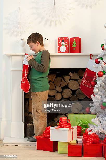 Young boy looking in Christmas stocking