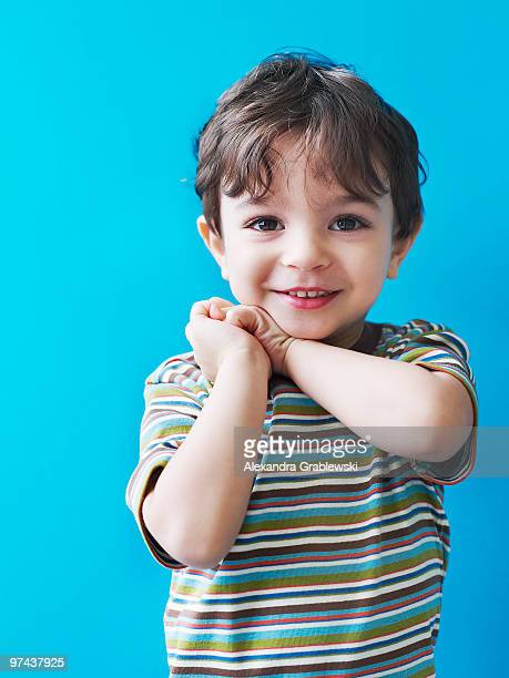 young boy looking pleased - baby boys stock pictures, royalty-free photos & images