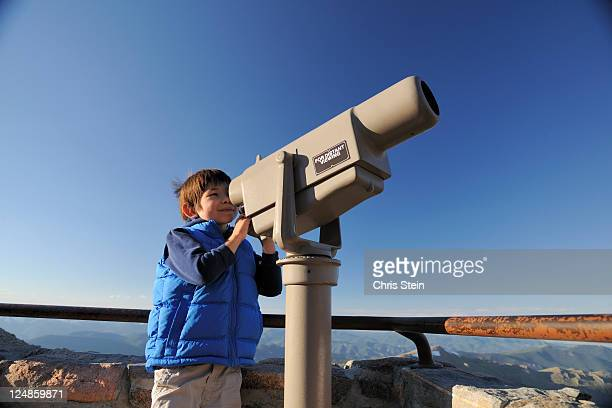 Young Boy looking through Scenic telescope