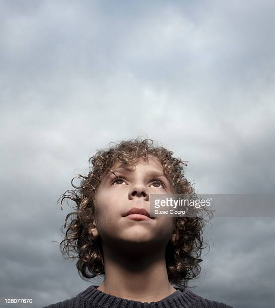 Young boy looking towards the sky