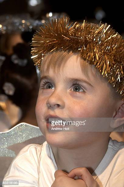 Young boy looking up smiling in school play