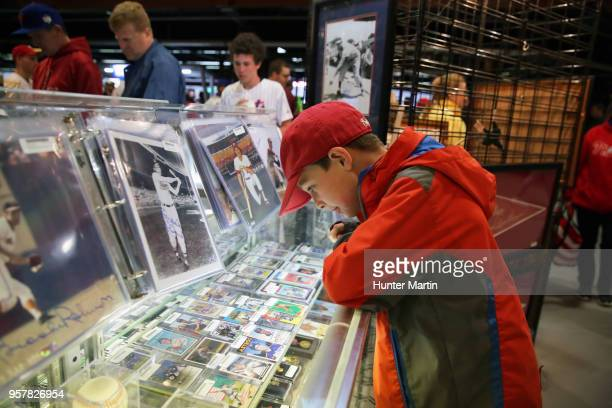 A young boy looks at a display of baseball cards during a rain delay before a game between the Philadelphia Phillies and the New York Mets at...