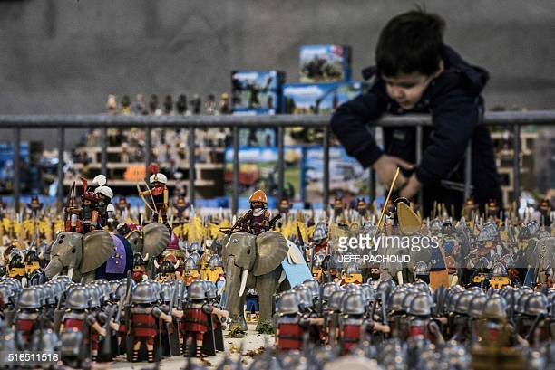 A young boy looks at a Playmobil diorama displaying the Battle of Zama fought in 202 BC consisting of more than 26000 figures at the sports hall of...