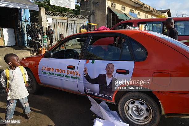 A young boy looks at a sticker on the side of a taxi part of an awareness raising campaign by the Independant Electoral Commission reading 'I love my...