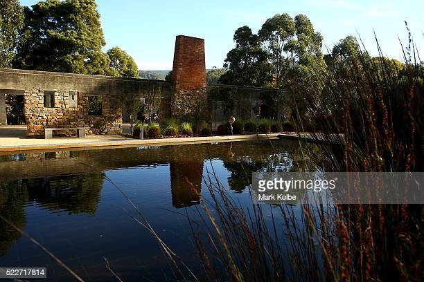 A young boy looks into the reflection pool in the Memorial Garden of the Port Arthur Historical Site on April 18 2016 in Port Arthur Australia The...