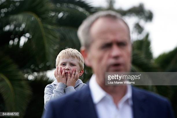 A young boy looks on as Opposition Leader Australian Labor Party Bill Shorten addresses the media at the Boathouse at Maribyrmong on July 3 2016 in...