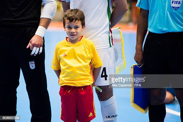 A young boy looks on as the National Anthems are played before the FIFA Futsal World Cup Group F match between Azerbaijan and Iran at Coliseo Ivan de...