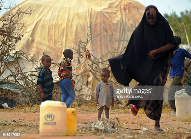 TOPSHOT A young boy looks on at Kenya's sprawling Dadaab refugee complex during a visit of Pakistani activist for female education and the...