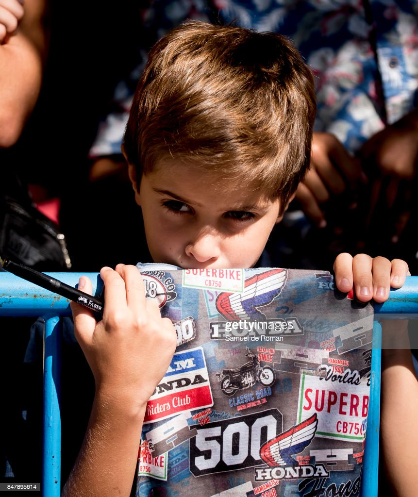 A young boy looks on during Funeral Tribute For Angel Nieto in Madrid on September 16, 2017 in Madrid, Spain.