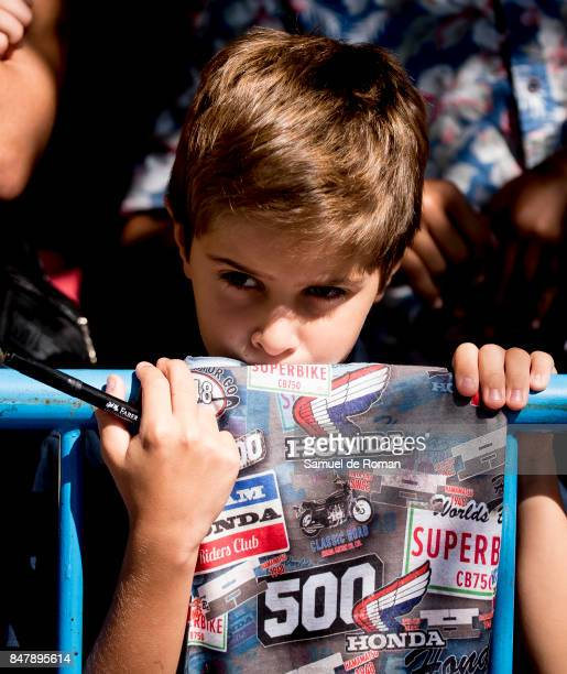 A young boy looks on during Funeral Tribute For Angel Nieto in Madrid on September 16 2017 in Madrid Spain