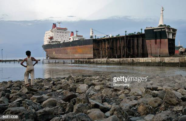 A young boy looks out at a tanker being scrapped at a Bangladeshi shipbreaking yard April 29 2005 near Chittagong Scrapped ships end up beached along...